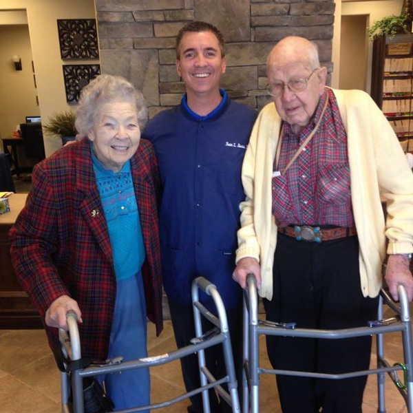Dr. Norris with Two Elderly Patients